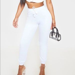 New white joggers w draw string PrettyLittleThing